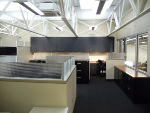 Exposing the ceiling in this office gives a modern feel and makes the space appear much larger than a traditional drop ceiling